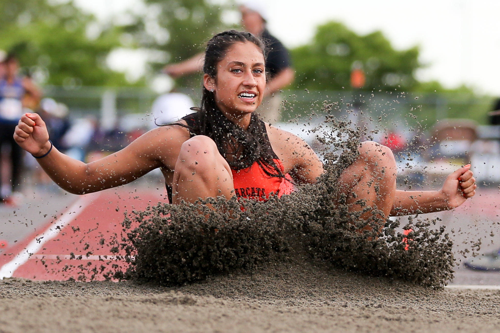 Monroe's Hannah Ganashamoorthy lands in the long jump during the Washington State Track and Field Meet at Mt. Tahoma High Stadium in Tacoma on May 23. (Kevin Clark / The Herald)