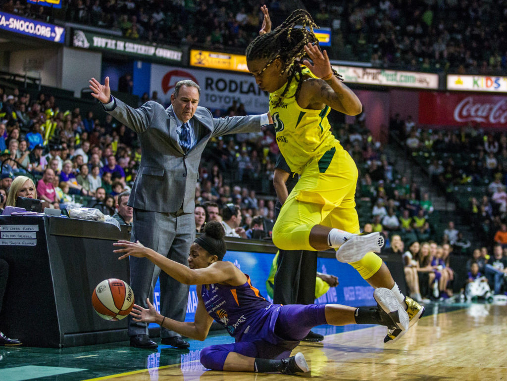 Seattle Storm's Shavonte Zellous scrambles for the ball with Phoenix Mercury's Arica Carter during the season opener game against the Phoenix Mercury on Saturday, May 25, 2019 in Everett, Wash. (Olivia Vanni / The Herald)