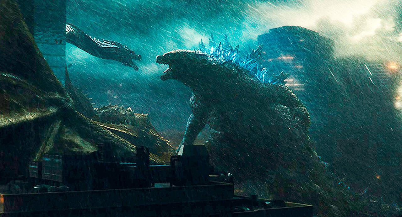 """As special effects-enhancing rains falls, prehistoric monsters square off in """"Godzilla: King of the Monsters."""" (Warner Bros. Pictures)"""