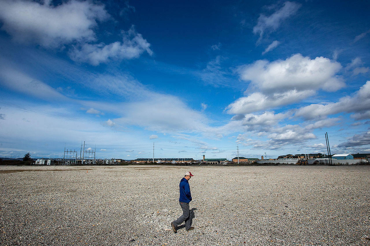 Bryan Lust, site manager for Kimberly-Clark, walks across the 66-acre former site of the company's Everett mill on in March 2017. (Ian Terry / Herald file photo)