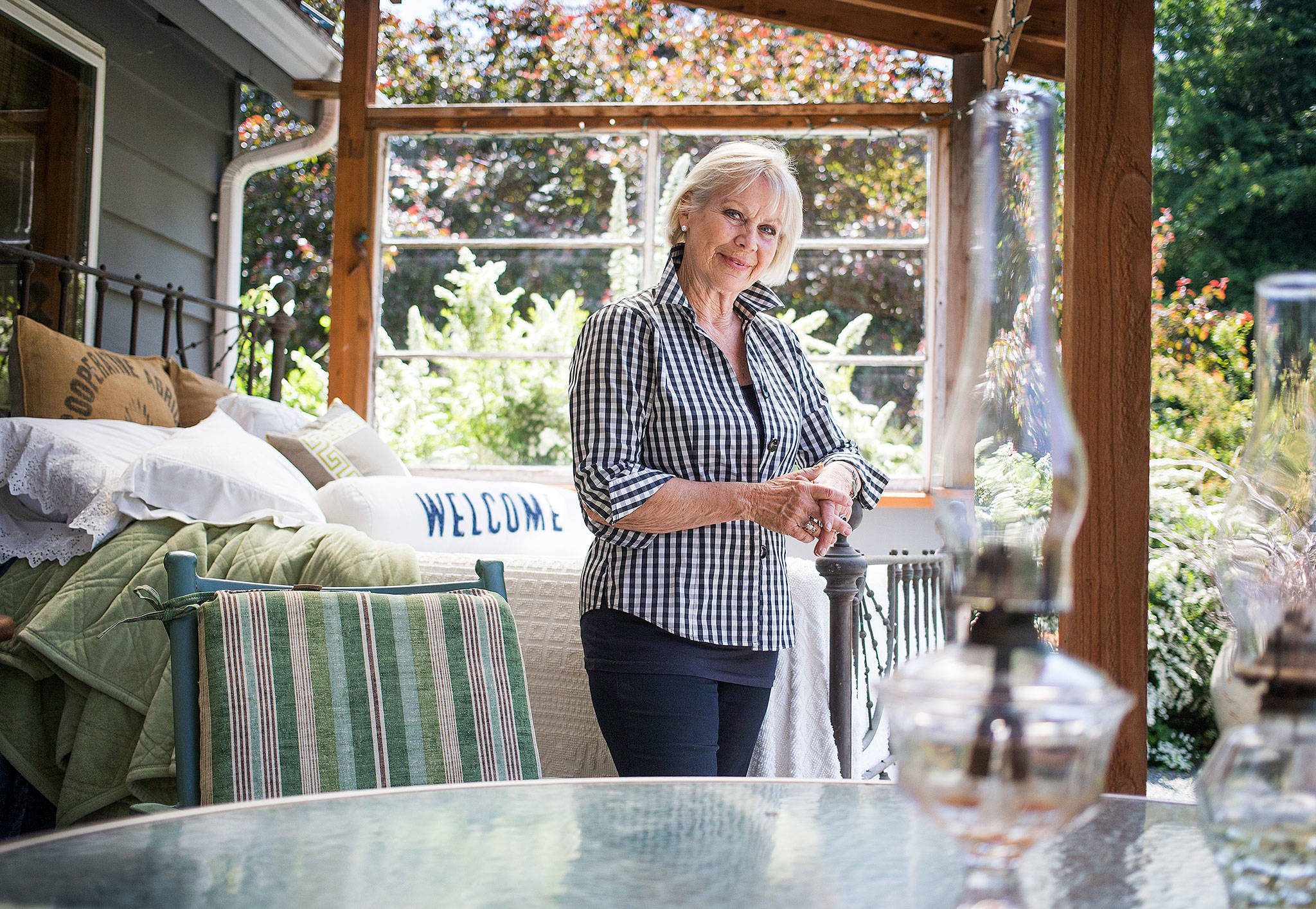 Bedroom furniture on a deck is one of the many touches Ellerie Cain, interior designer and owner of Ellerie's River Cottages, adds to her B&B cottages near the Stillaguamish River and Darrington. (Andy Bronson / The Herald)