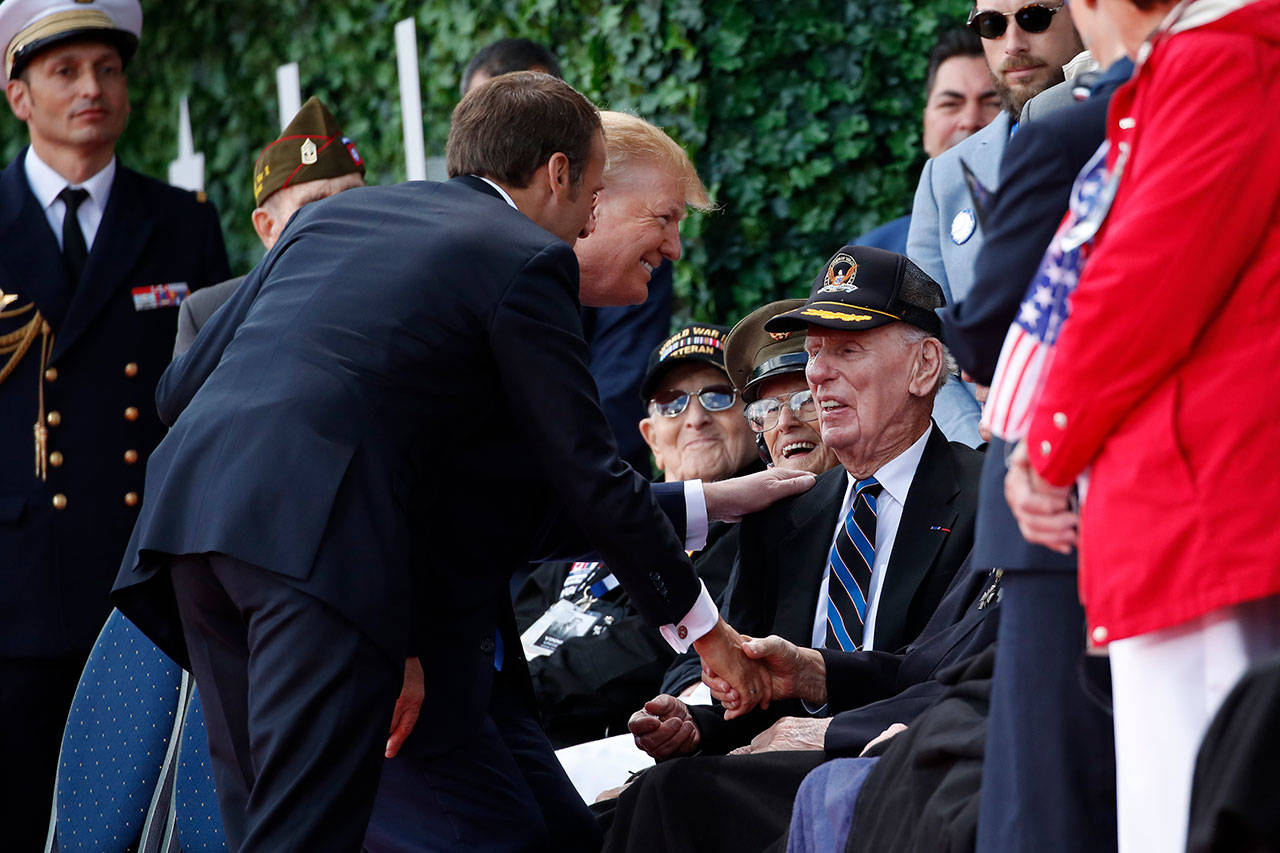 President Donald Trump and French President Emmanuel Macron greet veterans as they arrive to a ceremony to commemorate the 75th anniversary of D-Day at The Normandy American Cemetery on Thursday in Colleville-sur-Mer, Normandy, France. (AP Photo/Alex Brandon)
