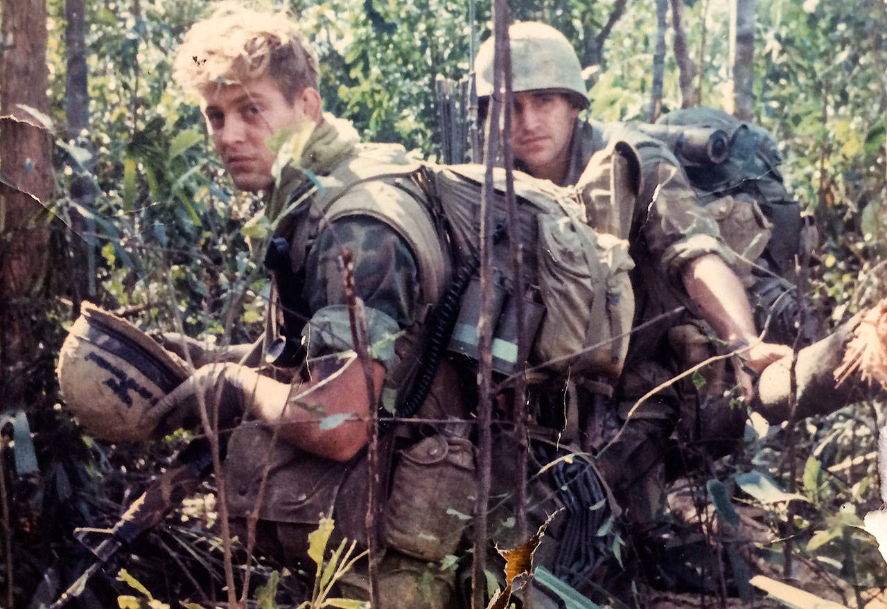 "Jim Thompson (left) and the Marines of Charlie Company spent weeks at a time ""out in the bush"" searching for the enemy, the North Vietnamese Army. (Family photo)"