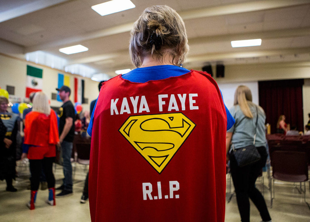 Lori Shile, a friend of Kaya's family, wears a Superman cape she made for Kaya's superhero-themed memorial at Emerson Elementary on June 1, 2019 in Everett. (Olivia Vanni / The Herald)