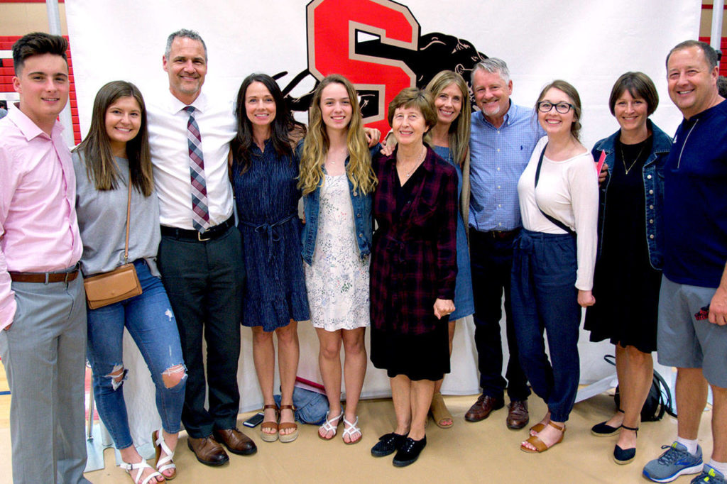 Snohomish High School scholarship recipient Maya DuChesne (middle) surrounded by members of the Roberts family. (Snohomish Education Foundation)