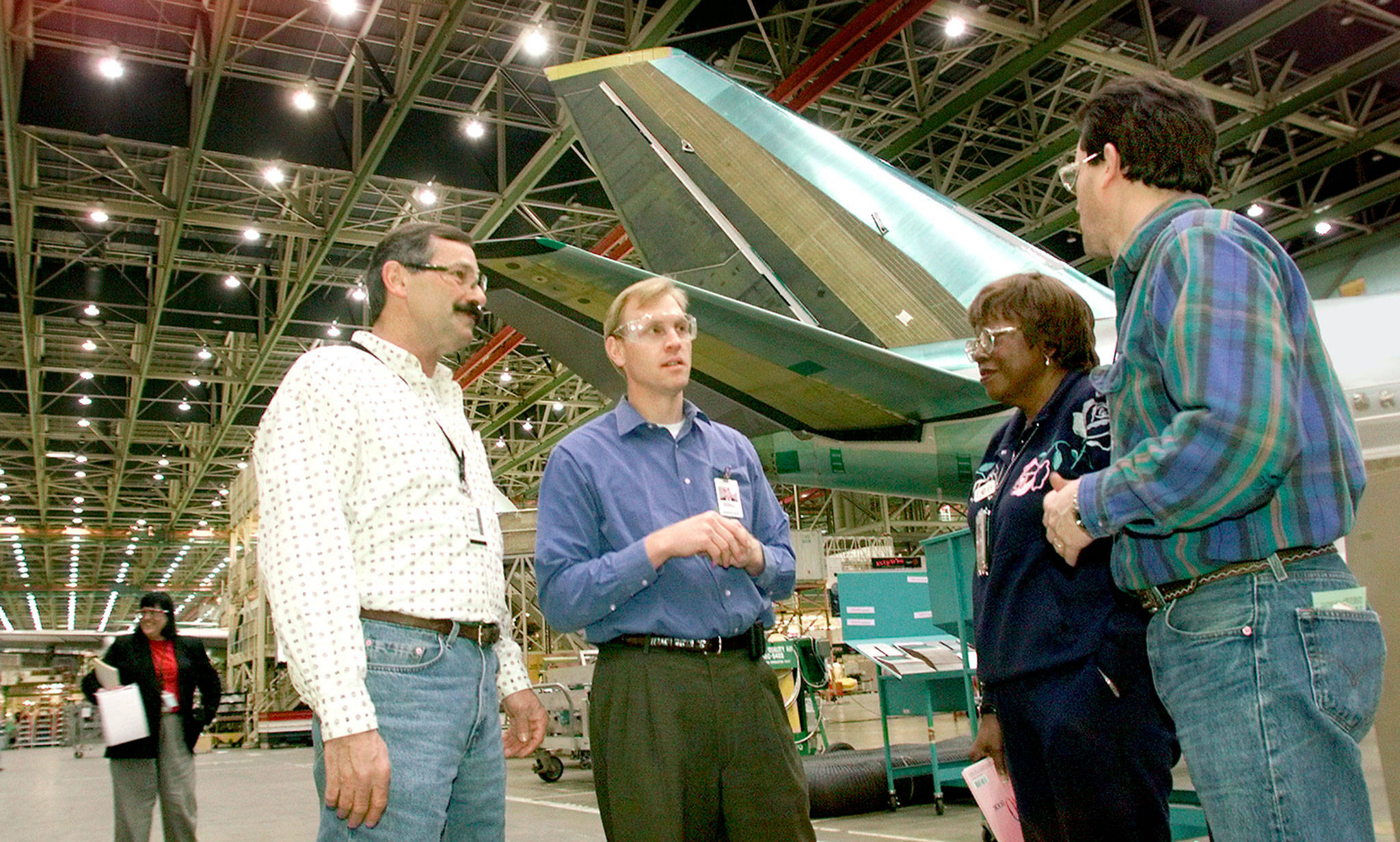 In 2005, Patrick Shanahan (second from left), then Boeing 767 project manager, confers with International Association of Machinists and Aerospace Workers union stewards at the Everett assembly plant. (Michael O'Leary / Herald file)