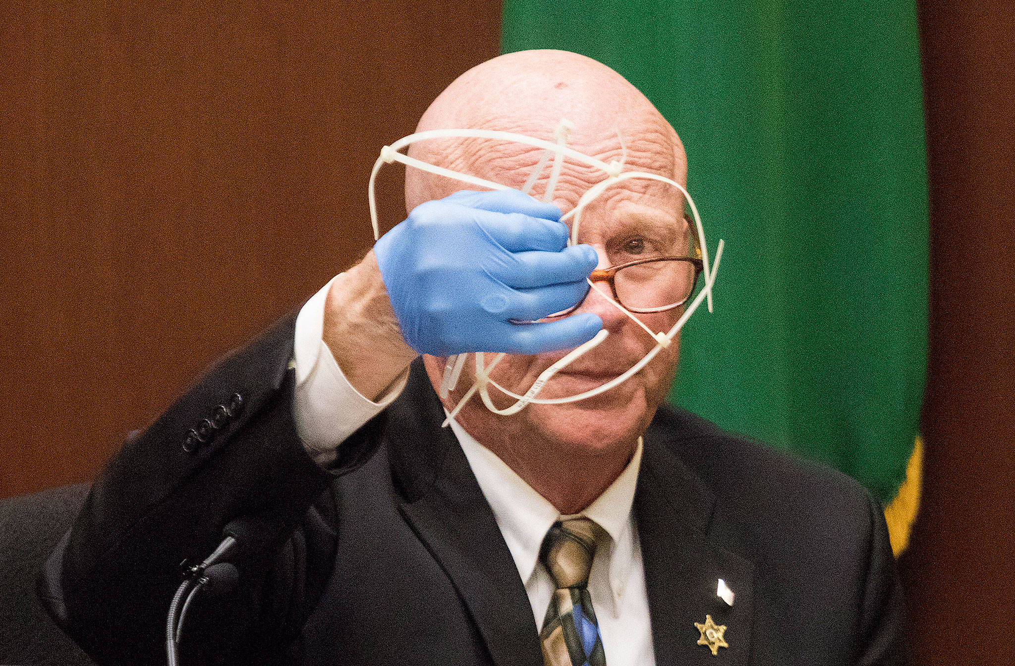 Retired Snohomish County detective and sheriff Rick Bart displays a group of zip ties, found near the body of Jay Cook, during his testimony at the trial for William Talbott II on Wednesday at the Snohomish County Courthouse in Everett. Talbott is on trial for the double-murder of Tanya Van Cuylenborg and Jay Cook. (Andy Bronson / The Herald/POOL)