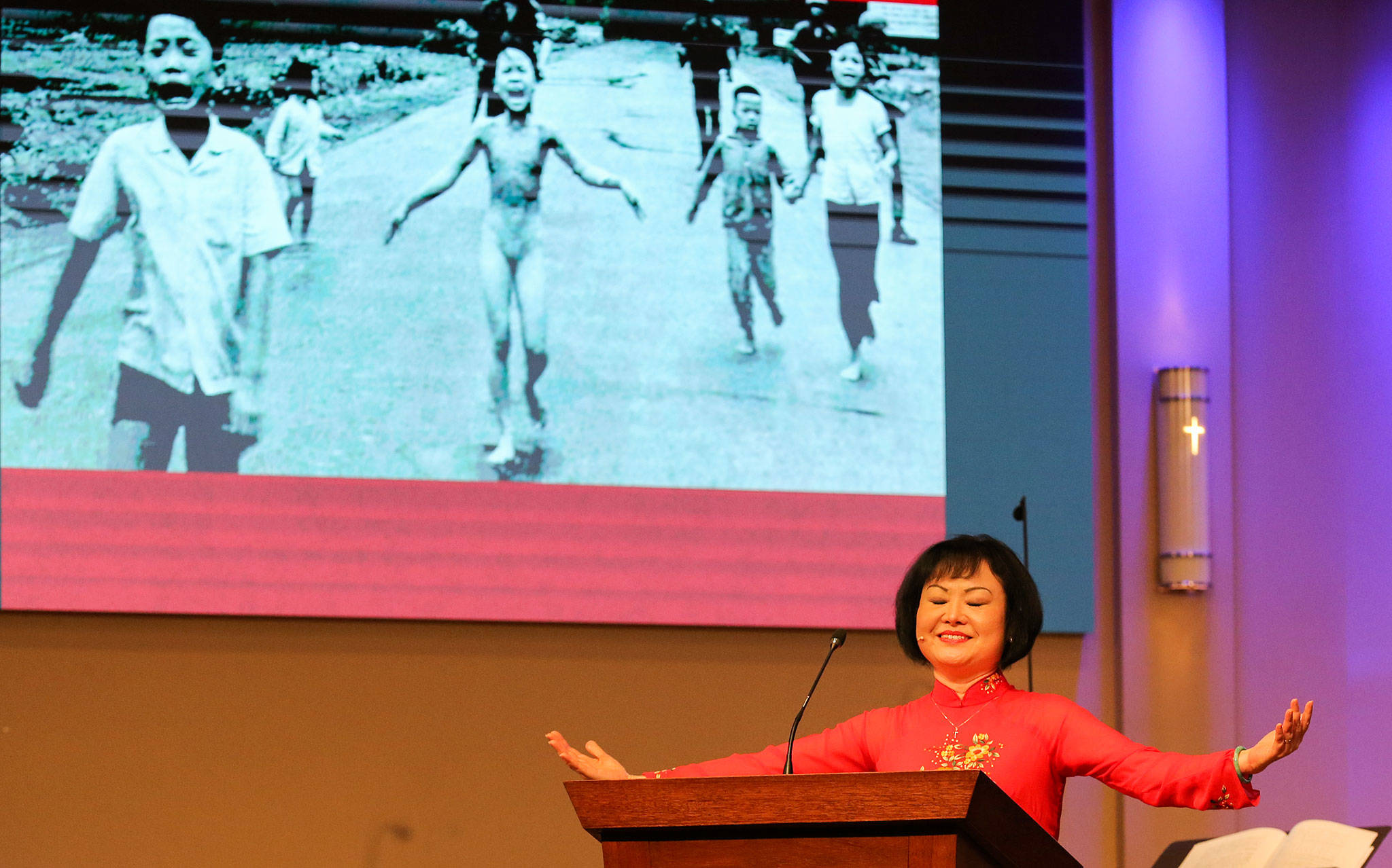 "Phan Thi Kim Phúc, known as ""The Napalm Girl"" because of a Vietnam War photograph of her as a child, addresses the congregation of Open Door Baptist Church in Lynnwood on Sunday morning. (Kevin Clark / The Herald)"