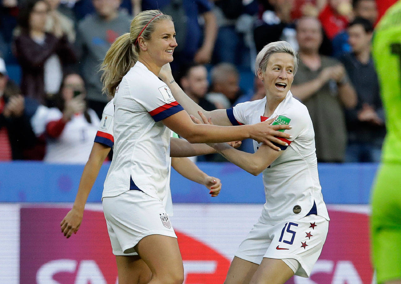 The United States' Lindsey Horan (left) is congratulated by Megan Rapinoe after scoring a goal during a Women's World Cup match against Sweden on June 20, 2019, in Le Havre, France. (AP Photo/Alessandra Tarantino)