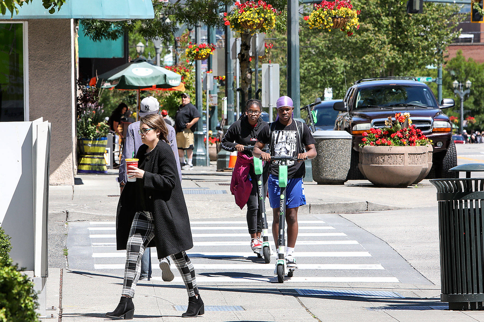 In May, 100 rentable e-scooters were placed in Everett and since have been whizzing down sidewalks in the city. (Lizz Giordano / The Herald)