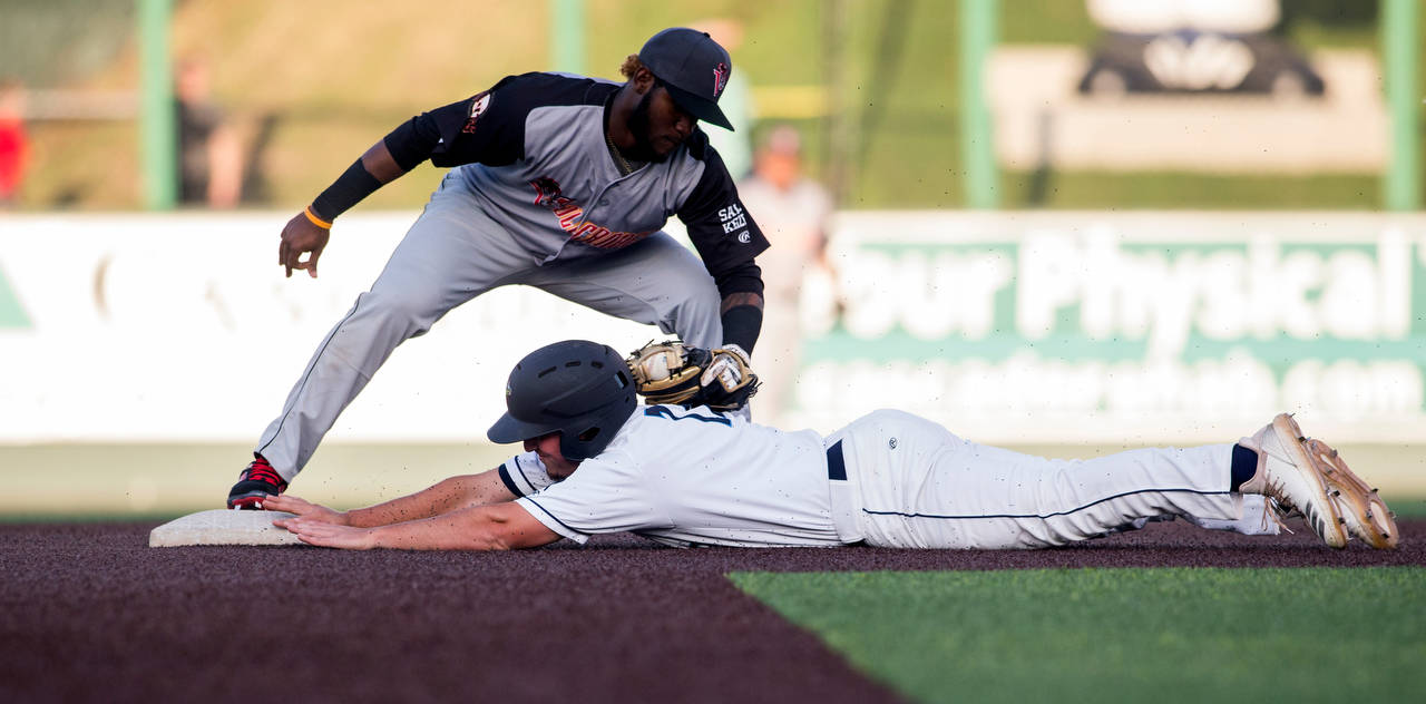 The AquaSox's Trent Tingelstad beats the tag at second base during Everett's home opener against the Volcanoes on June 21, 2019, at Funko Field at Everett Memorial Stadium. (Andy Bronson / The Herald)