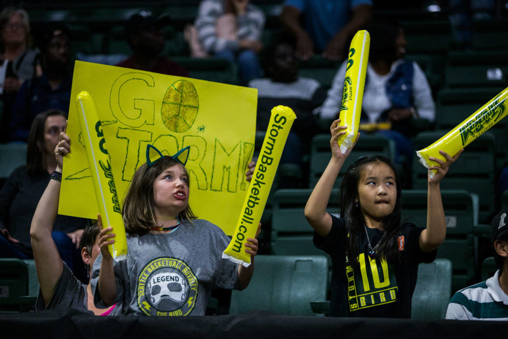 Seattle Storm fans cheer during the game against the Los Angeles Sparks at Angel of the Winds Arena on Friday, June 21, 2019 in Everett, Wash. (Olivia Vanni / The Herald)