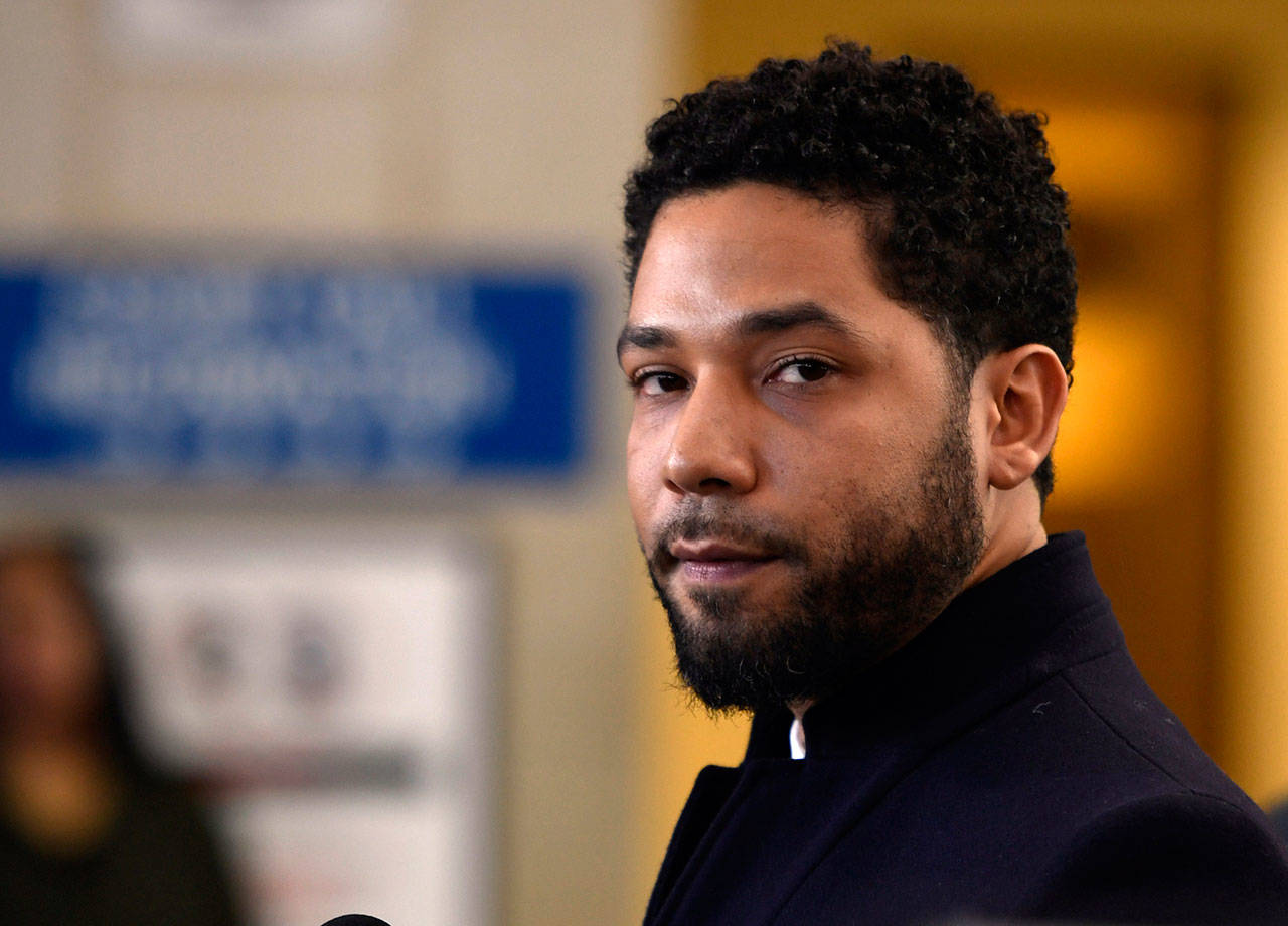 "Actor Jussie Smollett talks to the media before leaving Cook County Court in Chicago after his charges were dropped March 26. On Monday, Chicago police released hundreds of files from the investigation into Smollett's claim he was attacked by two men, including releasing video footage for the first time of the ""Empire"" actor wearing a thin white rope wrapped around his neck that he told detectives was a noose. (AP Photo/Paul Beaty, File)"