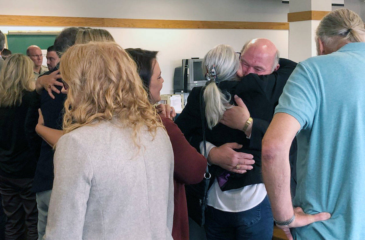 Detective Jim Scharf hugs Lee Cook, mother of Jay Cook, after a jury found William Talbott II guilty of two counts of aggravated murder in a trial that was the first of its kind. (Caleb Hutton / The Herald)
