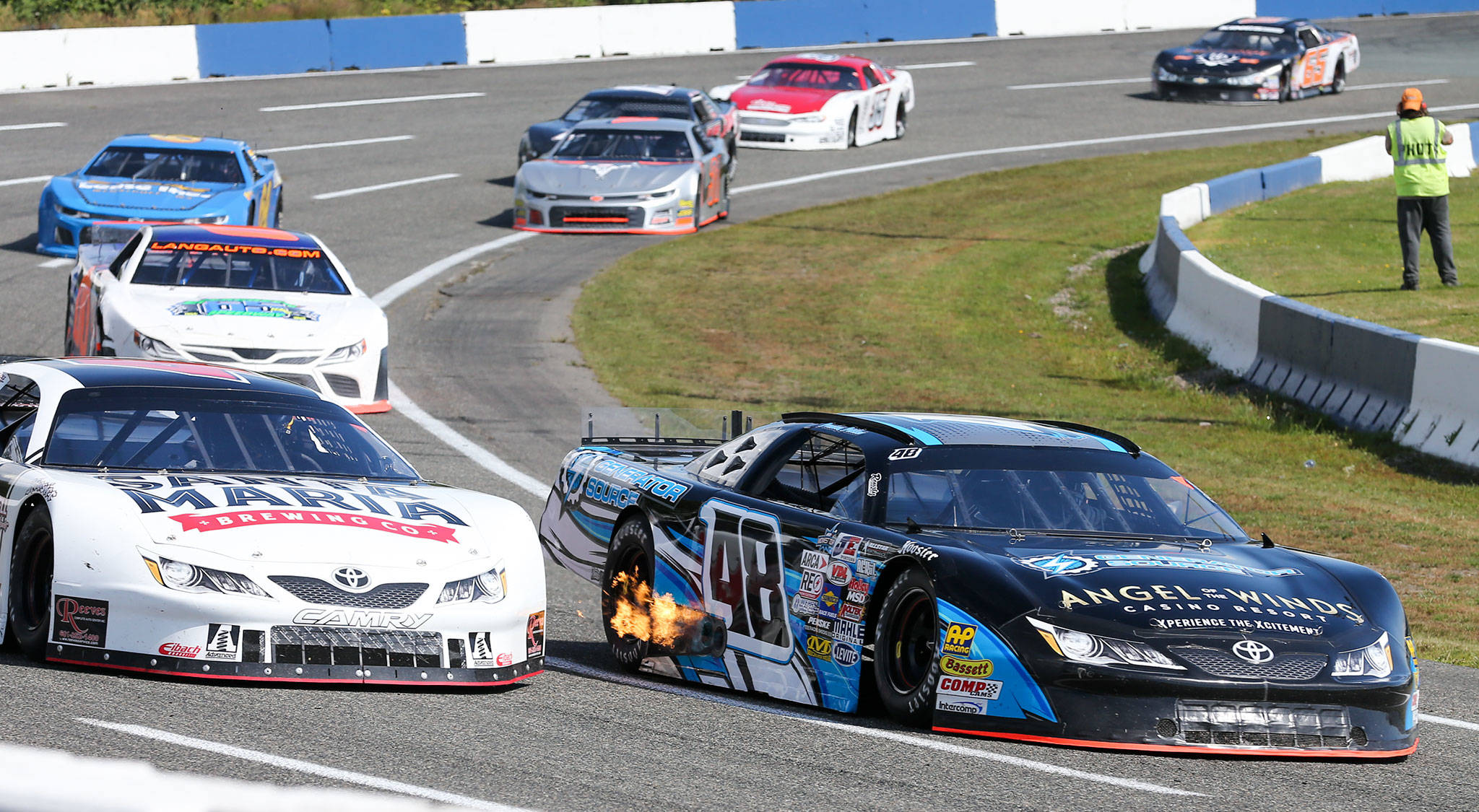 Preston Peltier, car 48, leads the pack in turn four Sunday afternoon during annual the Summer Showdown at the Evergreen Speedway in Monroe on June 30, 2019. (Kevin Clark / The Herald)