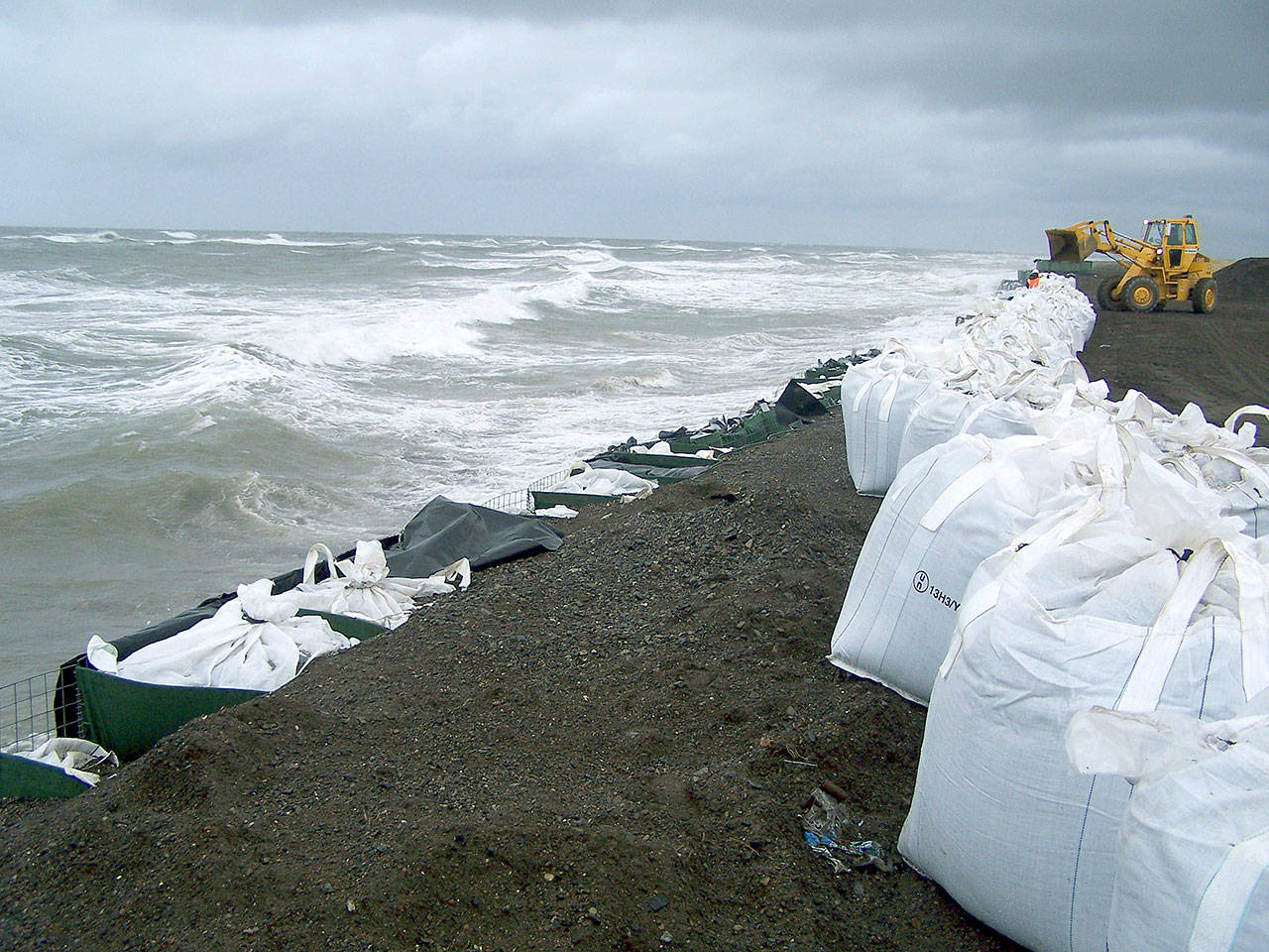 Sandbags are stacked along the seawall in Kivalina, Alaska, in September 2017. Northern Alaska coastal communities and climate scientists say sea ice disappeared far earlier than normal this spring and it's affecting wildlife. The Anchorage Daily News reported that ice melted because of exceptionally warm ocean temperatures. (AP Photo/Mary Sage, File)