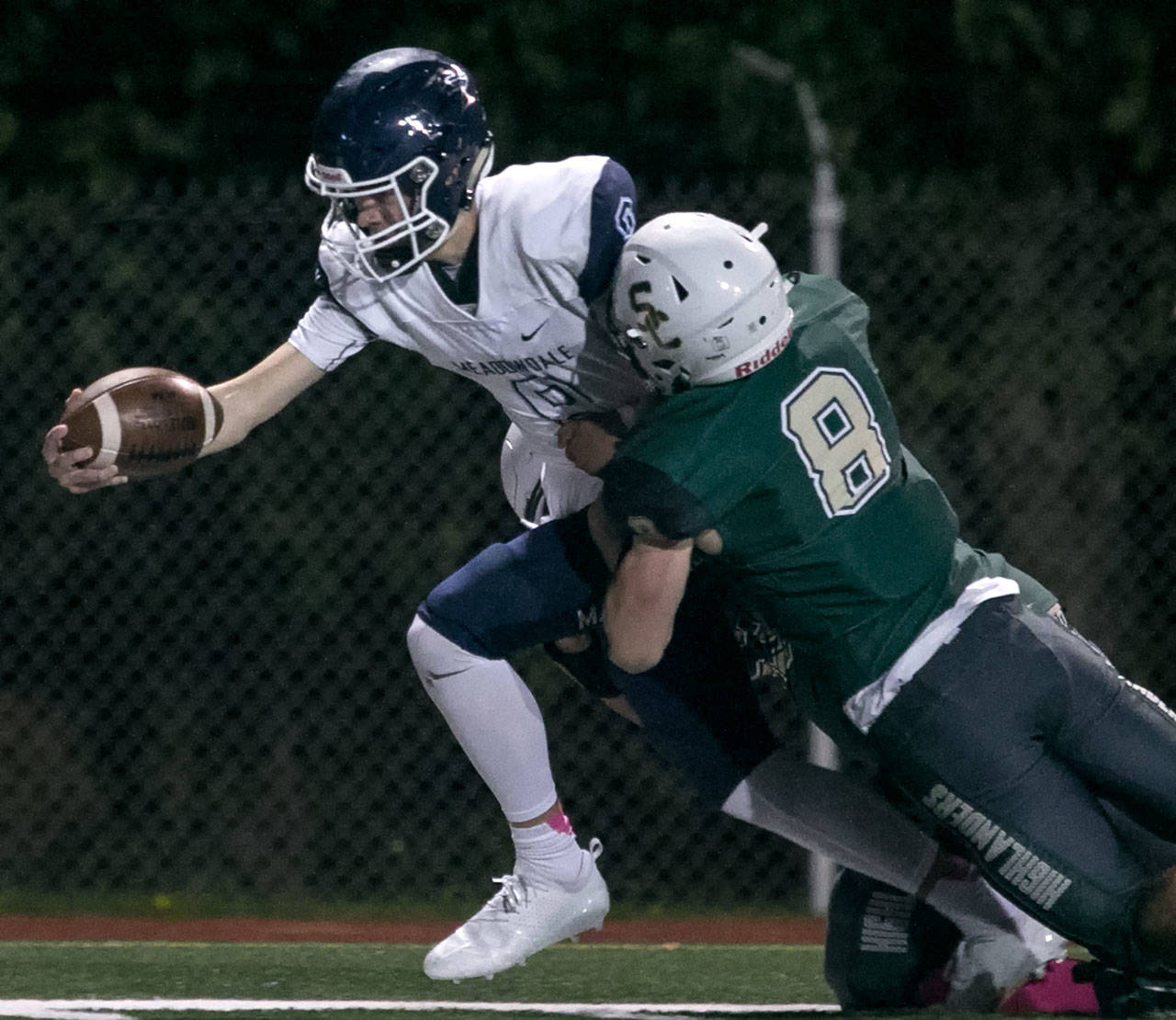 Quarterback Hunter Moen (left) and his Meadowdale teammates take on Edmonds School District rival Edmonds-Woodway in a key Wesco 3A South contest on Sept. 27. (Kevin Clark / The Herald)