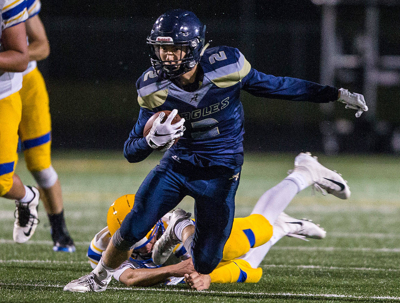 Wide receiver Bryce Petersen and Arlington had a flair for the dramatic last season, including another thriller against Oak Harbor. (Olivia Vanni / The Herald)