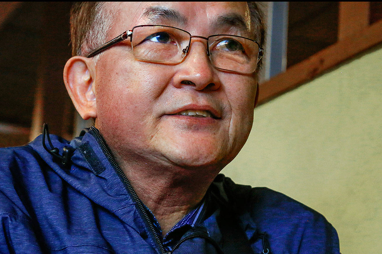 Lynnwood's Jin So, who came from South Korea in the 1970s, talks about President Donald Trump's step across the DMZ into North Korea last weekend. (Dan Bates / The Herald)
