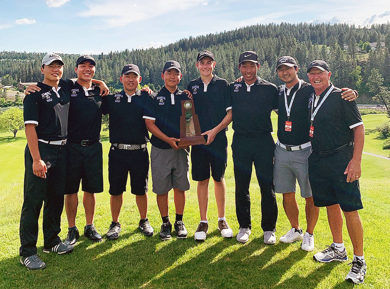 The Kamiak boys golf team celebrates after winning the 4A state title. (Photo provided)