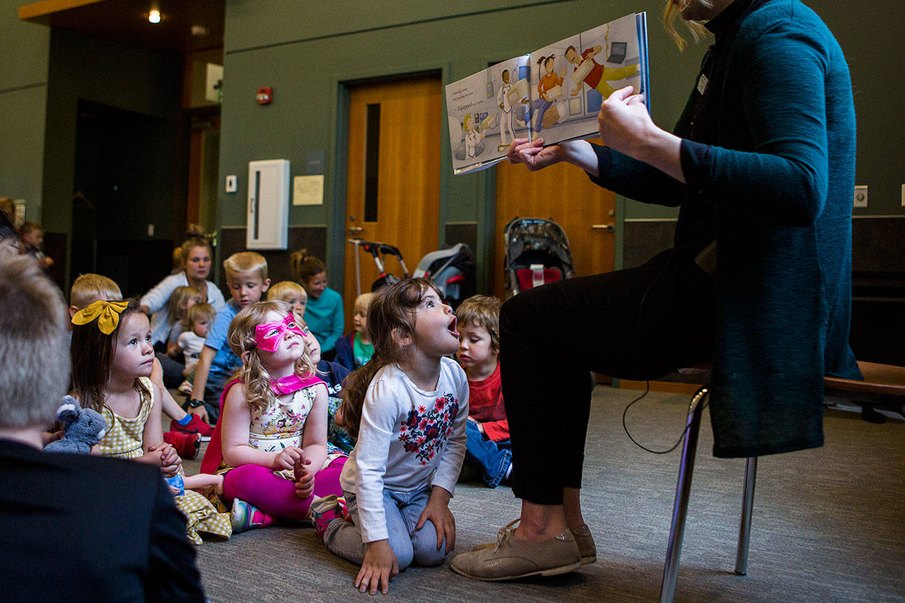 Riley Humphrey, 3, reacts to the story being read by Shannon Horrocks during Ms. Shannon's story time at the Snohomish Library on Wednesday, May 15, 2019 in Everett, Wash. (Olivia Vanni / The Herald)