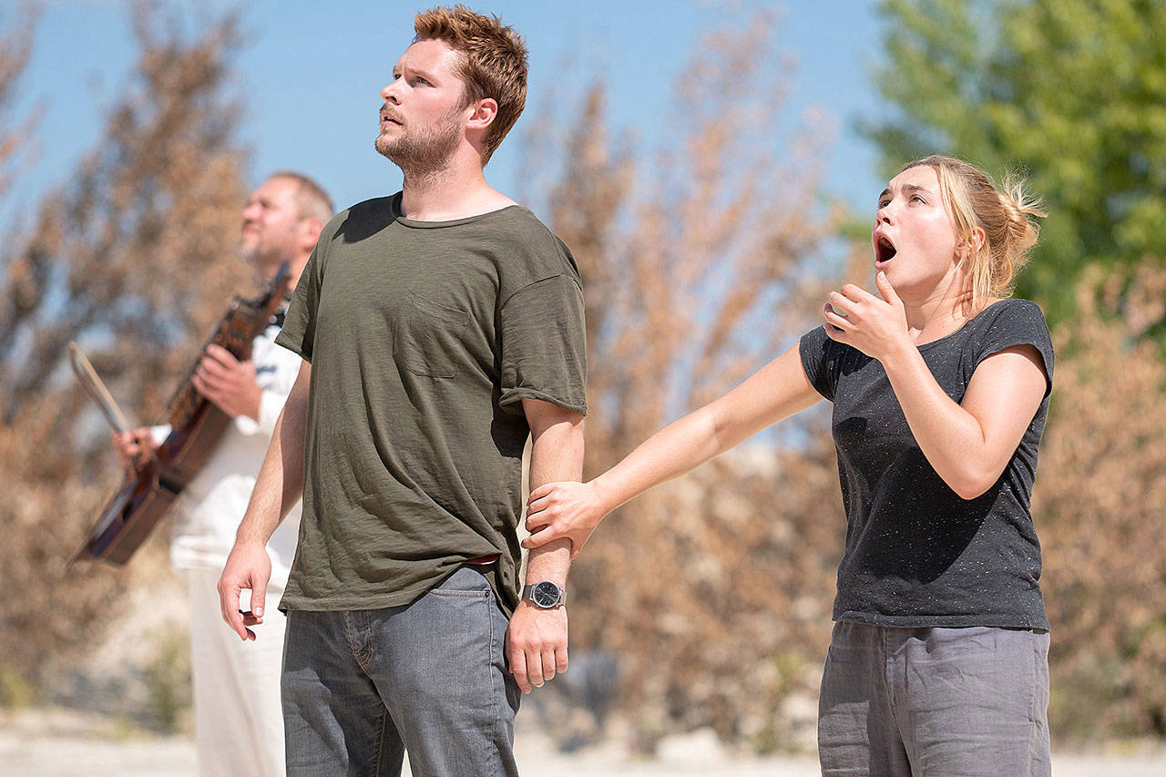 "Florence Pugh and Jack Reynor take in the unsettling sights of a creepy Swedish commune in ""Midsommar."" (A24)"