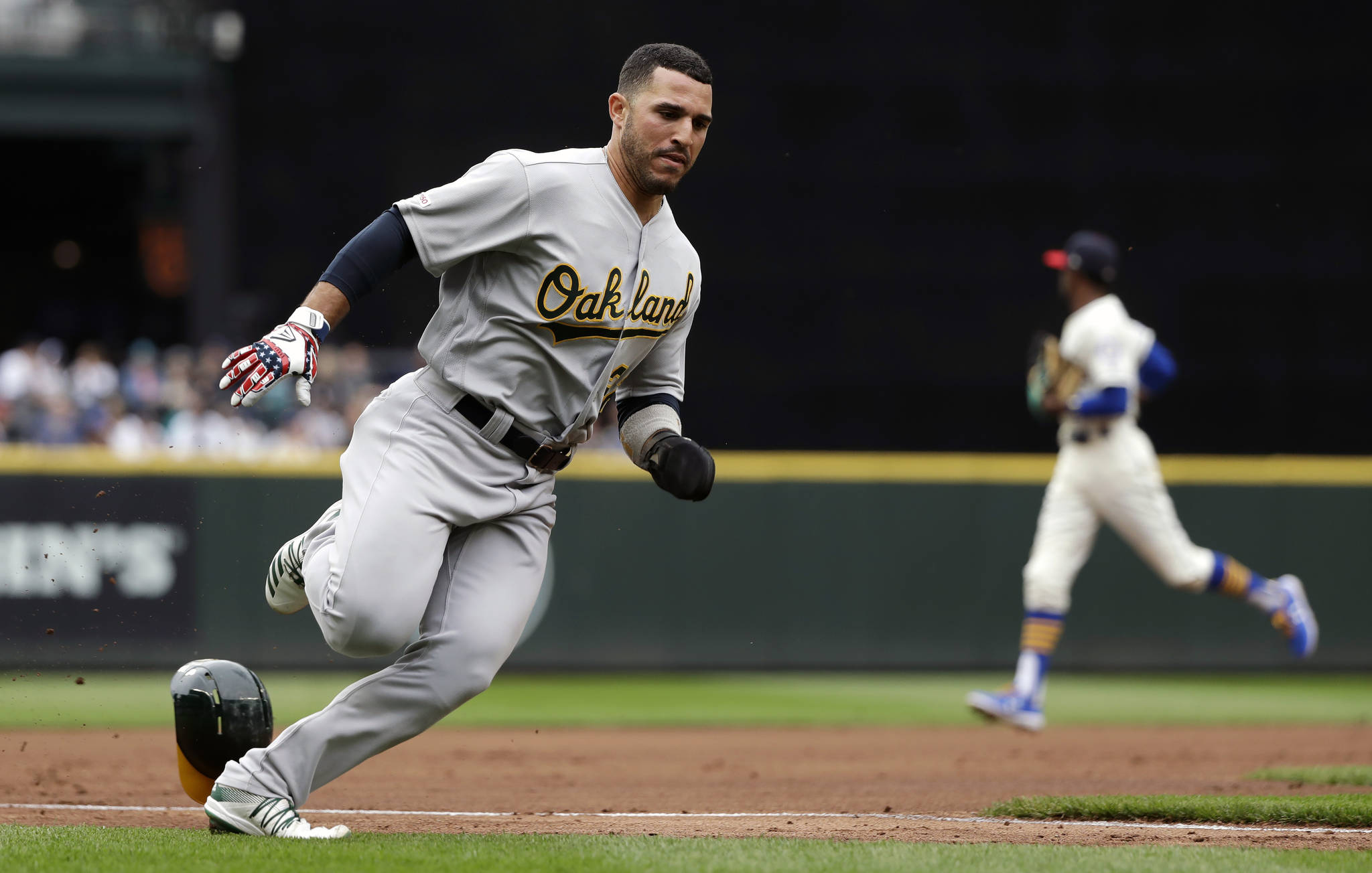 Oakland's Ramon Laureano races home to score against the Seattle Mariners in the first inning of Sunday's game at T-Mobile Park in Seattle. (AP Photo/Elaine Thompson)