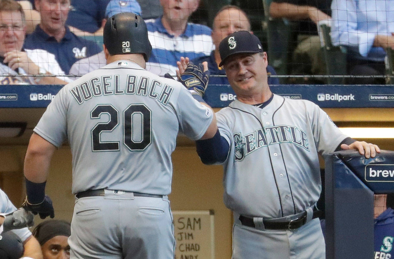The Mariners' Daniel Vogelbach is congratulated by manager Scott Servais after hitting a home run during a game against the Brewers on June 25, 2019, in Milwaukee. (AP Photo/Morry Gash)
