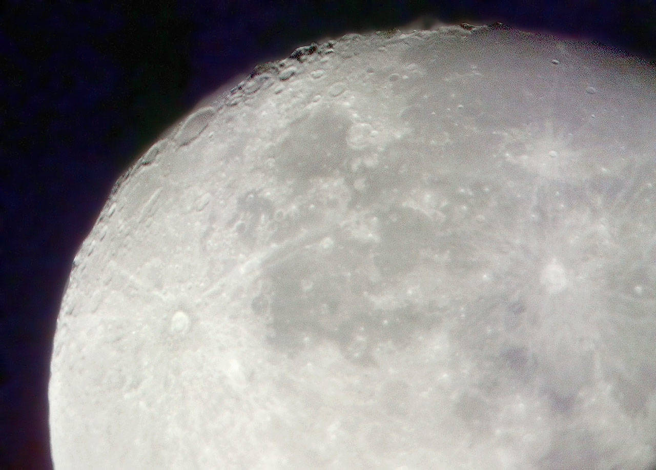 A photo of the moon taken in 2002 through Mark Folkerts' 16-inch truss-tube Dobsonian reflector telescope. (Justin Best / Herald file)