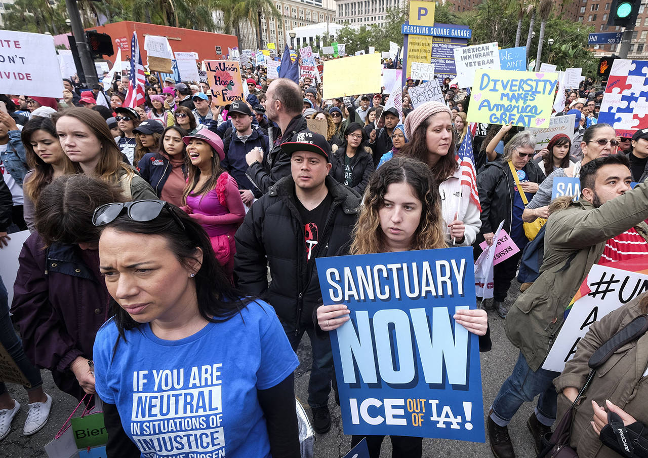 """In this Feb. 18, 2017 photo, thousands of people take part in the """"Free the People Immigration March,"""" to protest actions taken by President Donald Trump and his administration, in Los Angeles. (AP Photo/Ringo H.W. Chiu, File)"""