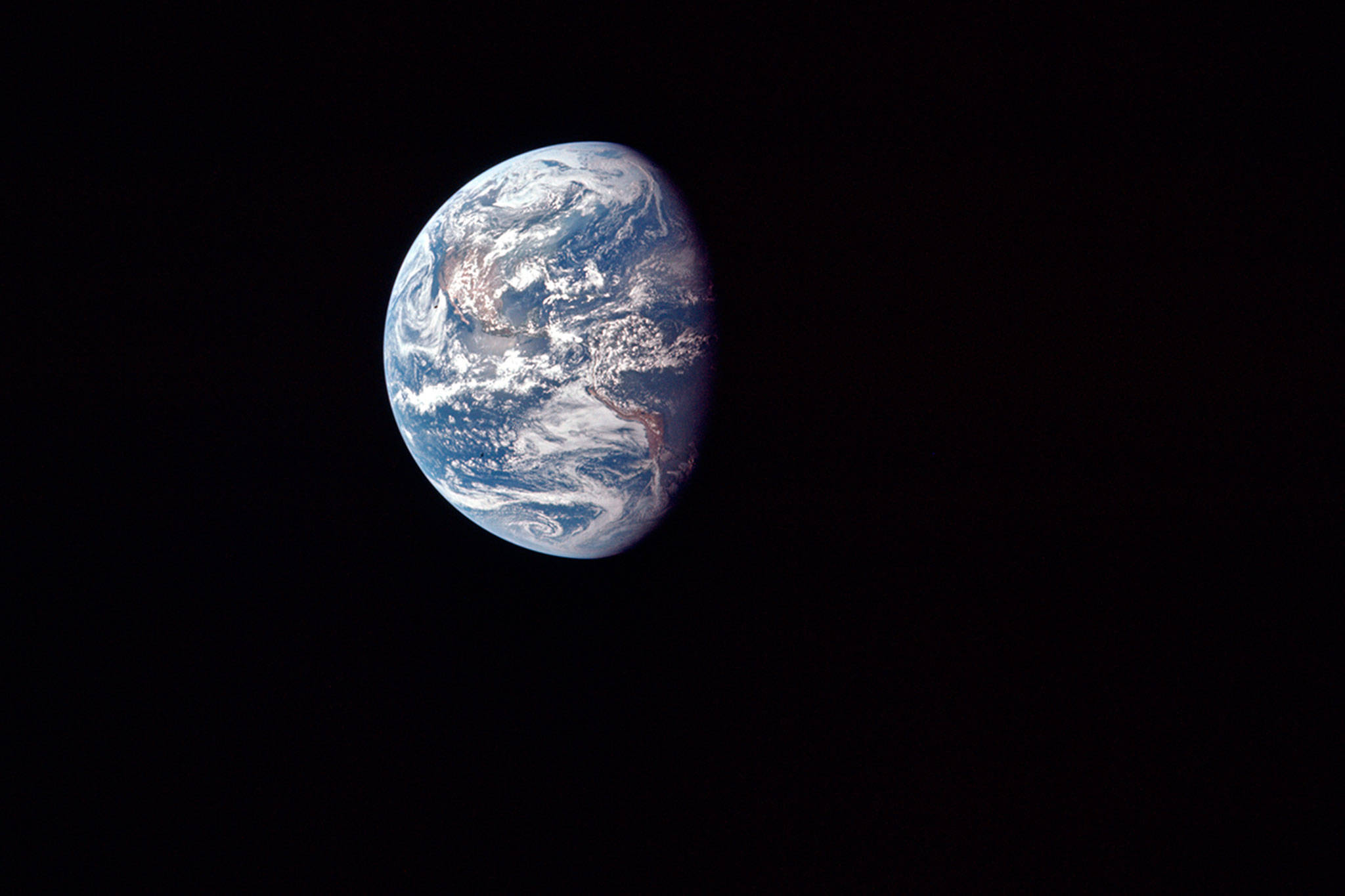 This July 17, 1969 photo made available by NASA shows the Earth as the Apollo 11 mission travels toward the moon. It's estimated that about 600 million people around the world watched as Neil Armstrong and Buzz Aldrin landed on the moon in 1969. (NASA via AP)