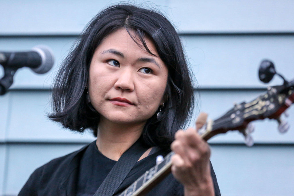 Kate Fujimoto of Cave Swallows performs during The Garden Series in Everett's Riverside neighborhood June 28. The summer music event host local bands in an intimate backyard venue. (Kevin Clark / The Herald)