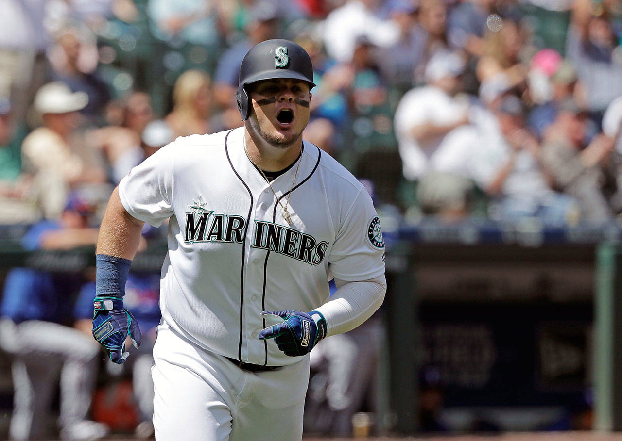 The Mariners' Daniel Vogelbach reacts after hitting a solo home run during the fifth inning of a game against the Rangers on July 24, 2019, in Seattle. (AP Photo/Ted S. Warren)
