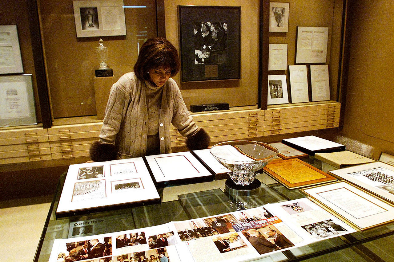 Linda Johnson Rice, president and chief operating officer of Jet magazine, looks over awards and recognitions won by the magazine in its 50-year lifetime at Jet's Chicago headquarters in 2001. (AP Photo/Ted S. Warren, File)