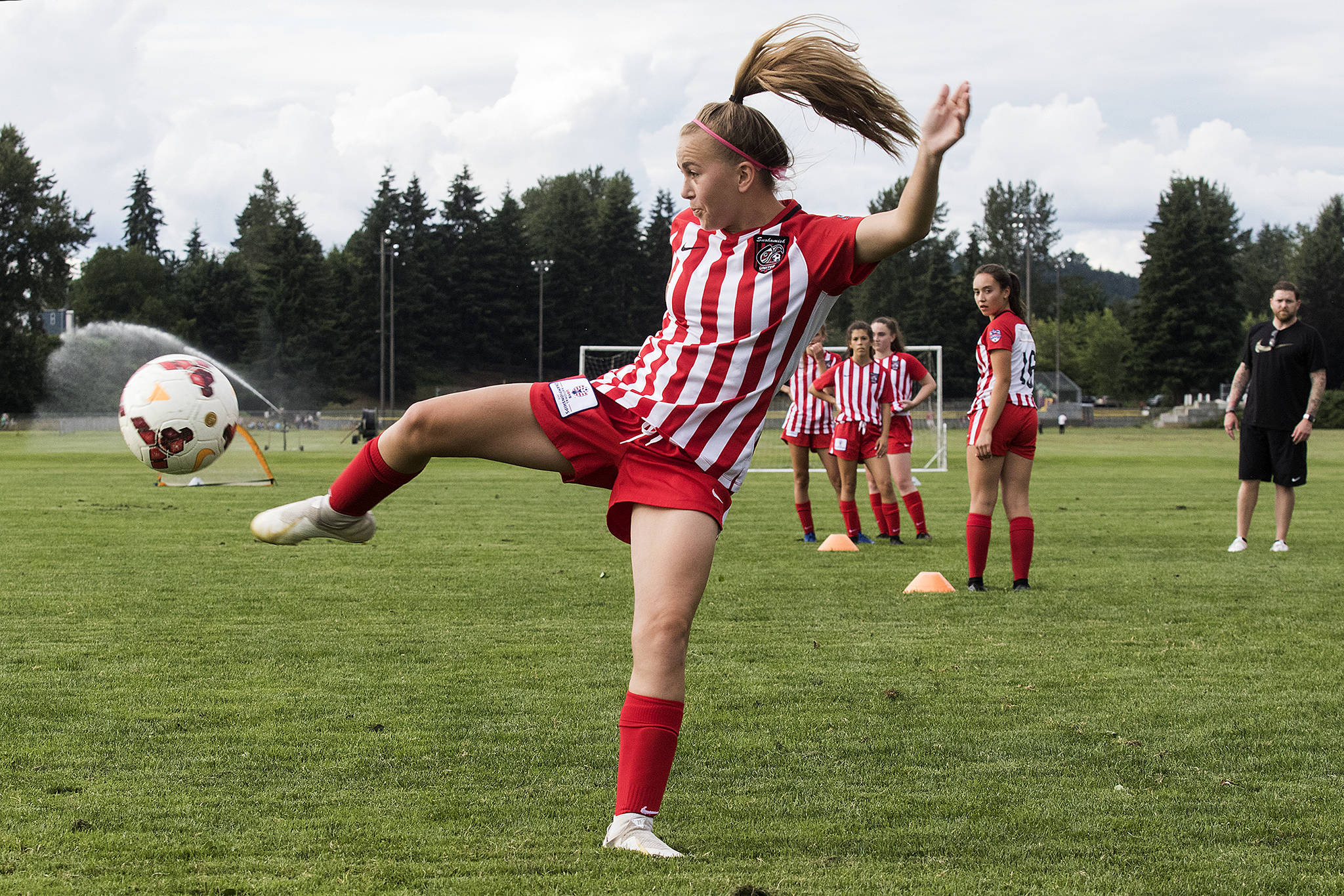 Snohomish United 05's Kenzie Thompson-Sheldon tries a side kick toward the goal during practice at Stocker Fields July 11 in Snohomish. (Andy Bronson / The Herald)