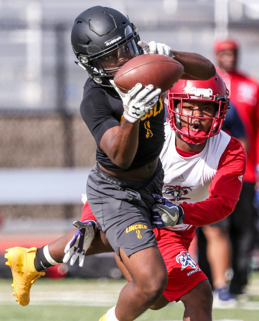 Lincoln's Majesty Irvin makes a catch with Kennedy Catholic's AJ Keys trailing Saturday afternoon during the Cougar Championship Passing Tournament at Lakewood High School in Marysville on July 27, 2019. (Kevin Clark / The Herald)