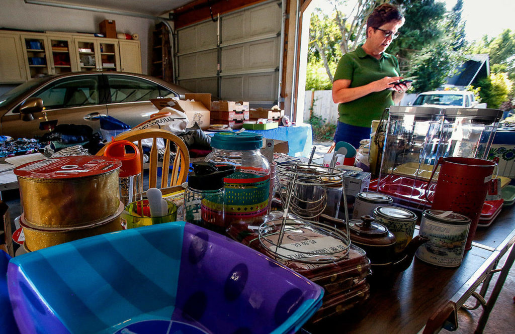 Carol Wheeler is busy preparing for Saturday's Mother of All Garage Sales in Everett's Northwest Neighborhood. For years, Wheeler did the sale as a fundraiser for a Girl Scout troop. She sells vintage Christmas items, antique teacups, clothing and other items. (Dan Bates / The Herald)