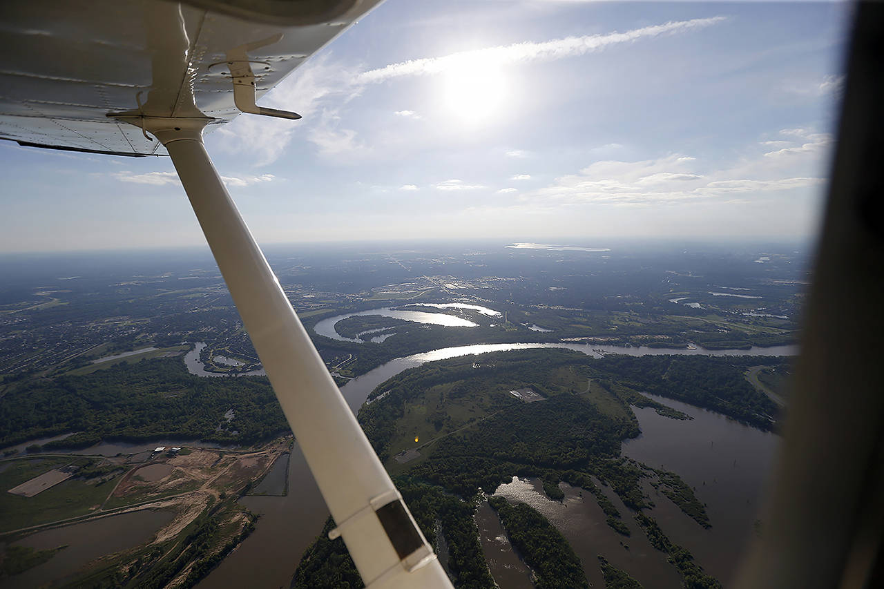In this 2017 photo, the Red River is seen in this aerial photo from a private plane near Shreveport, Louisiana. The Department of Homeland Security plans to issue a security alert Tuesday for small planes, warning that modern flight systems are vulnerable to hacking if someone manages to gain physical access to the aircraft. (AP Photo/Gerald Herbert, file)