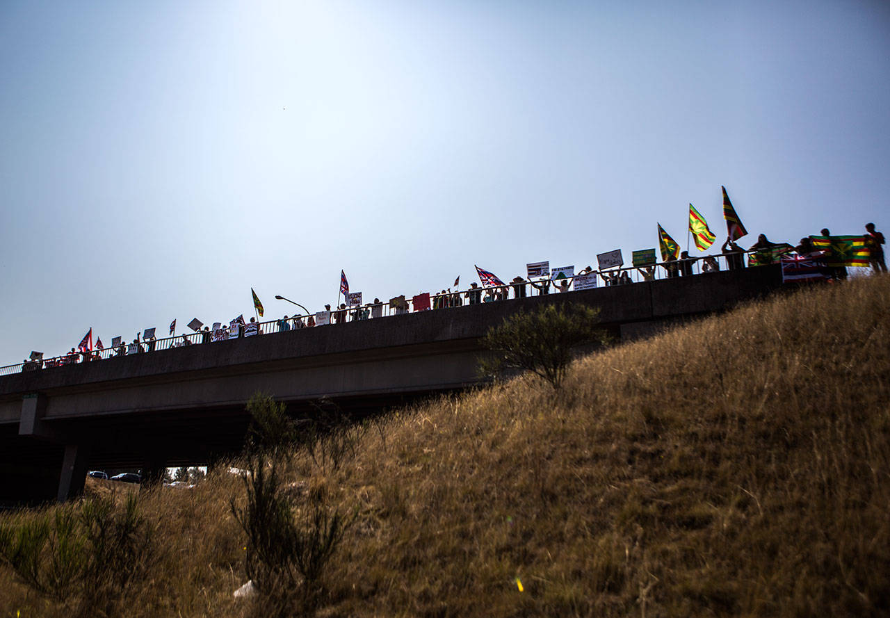 Hundreds gather along the I-5 overpass between Marysville and Quil Ceda in protest Saturday in Marysville. (Olivia Vanni / The Herald)