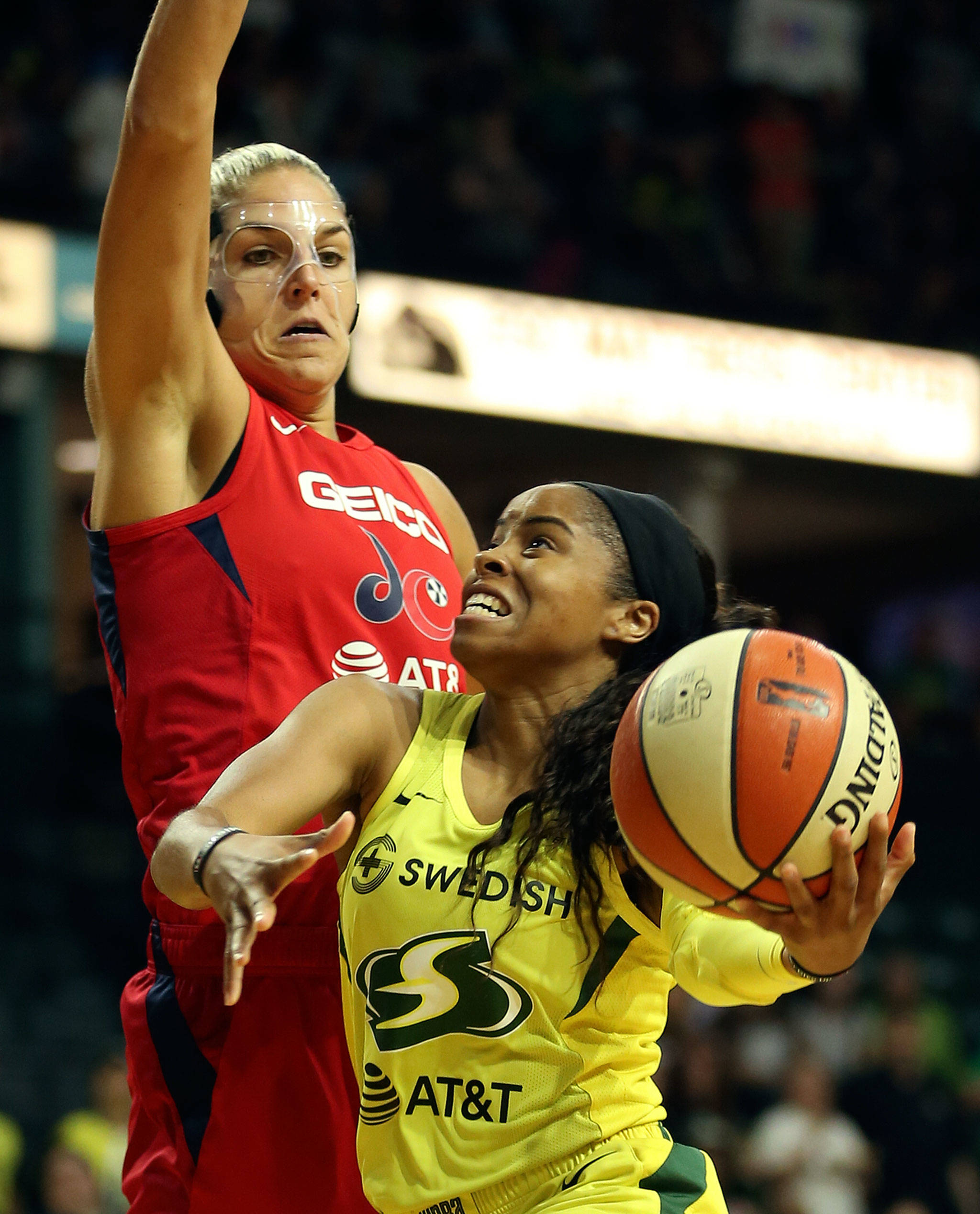 Seattle's Jordin Canada attempts a shot with Washington's Elena Delle Donne defending during a game on Aug. 2, 2019, at Angel of the Winds Arena in Everett. (Kevin Clark / The Herald)