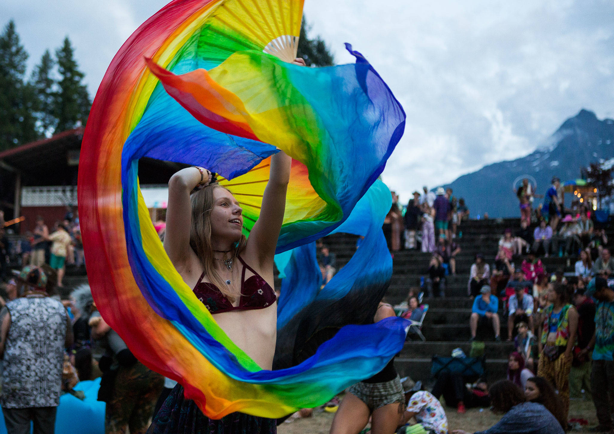 Mya Hossack dances with rainbow fans during Umphrey's McGee during the second day of Summer Meltdown on Friday, Aug. 2, 2019 in Darrington, Wash. (Olivia Vanni / The Herald)