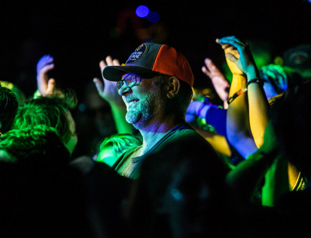 A festival goer smiles during Umphrey's McGee during the second day of Summer Meltdown on Friday, Aug. 2, 2019 in Darrington, Wash. (Olivia Vanni / The Herald)