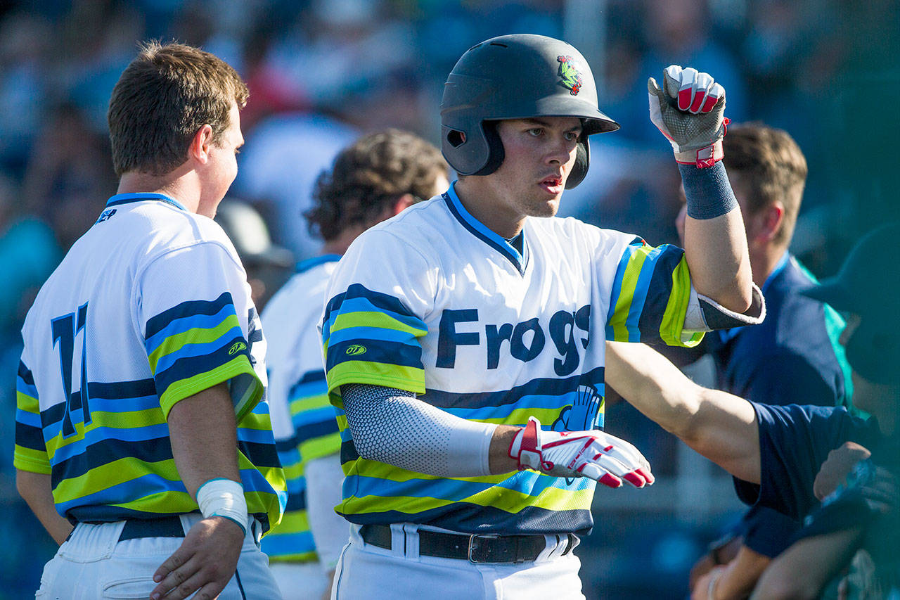 Everett AquaSox catcher Brennon Kaleiwahea gets high-fives from his teammates after hitting a home run Aug. 4 during a game against Spokane at Funko Field at Everett Memorial Stadium in Everett. (Olivia Vanni / The Herald)