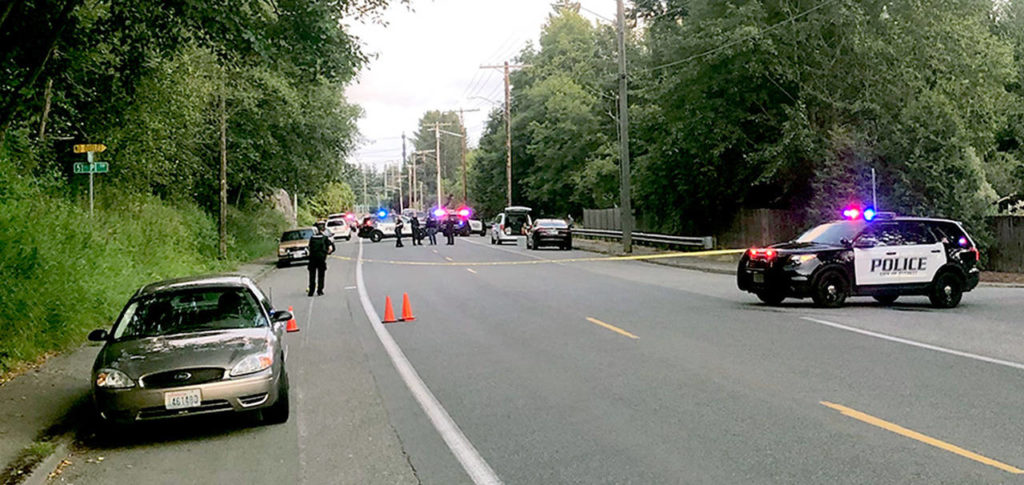 Police respond to the scene of an apparent road rage shooting on Glenwood Avenue near 51st Place SW in Everett on July 6. One man was killed. (Janice Podsada / Herald file)