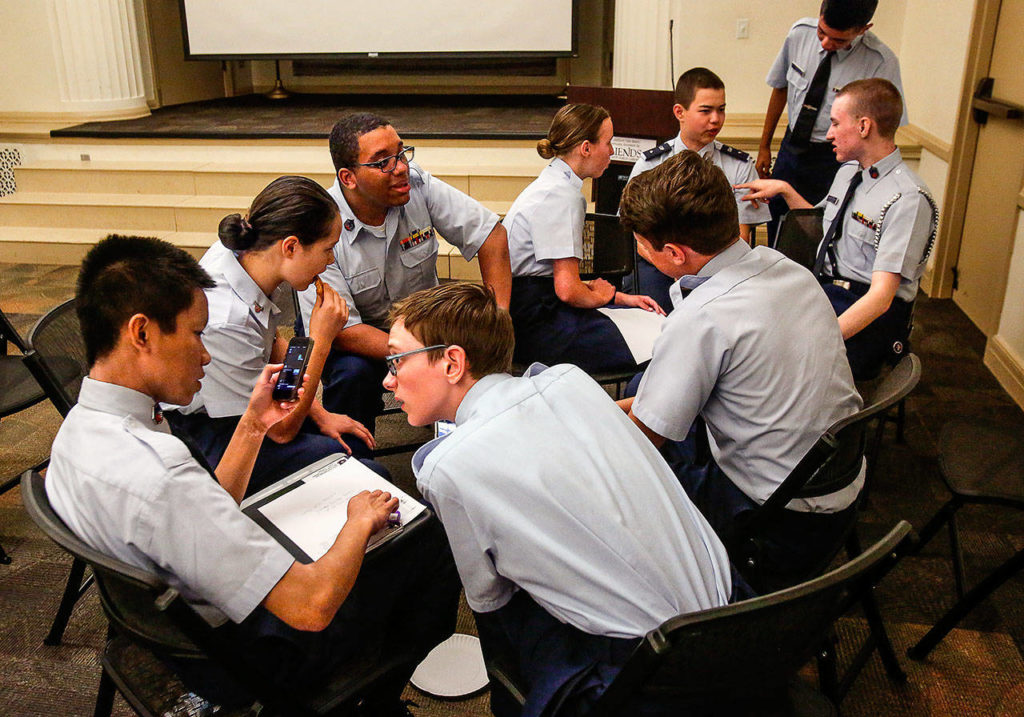 Teens who are part of the Civil Air Patrol's Overlake Composite Squadron interviewed and made videos of veterans at the Everett Public Library Monday. (Dan Bates / The Herald)