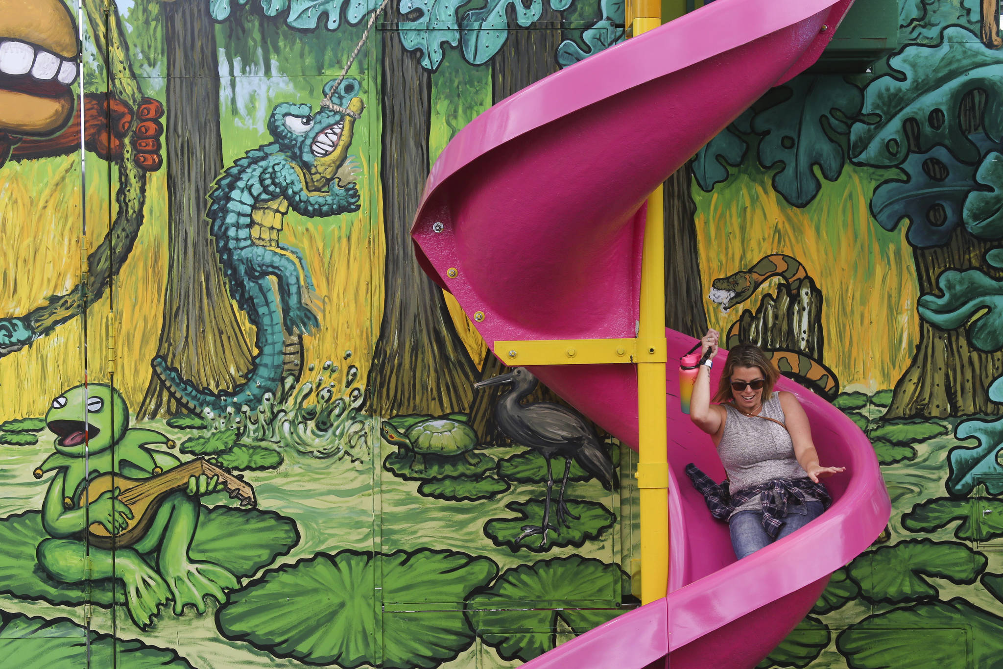 Even the adults can have fun as Tiara Wallner, of Lake Stevens, does sliding down the Monkey Maze slide on opening day of the Evergreen State Fair on Thursday, Aug. 22, 2019 in Monroe, Wash. (Andy Bronson / The Herald)
