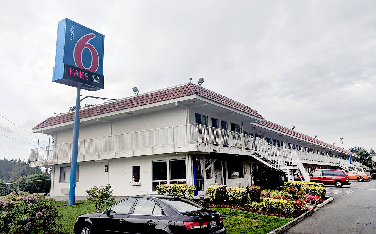 A man was stabbed to death inside this Motel 6 south of Everett early Friday morning. (Zachariah Bryan / The Herald)