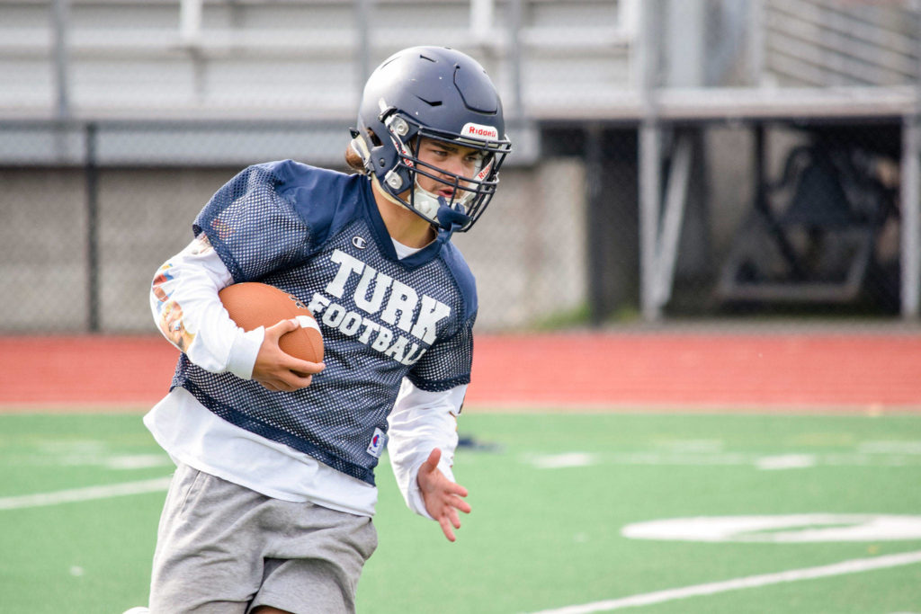 Sultan junior Zane Sailor runs with the ball during practice on Aug. 23, 2019, at Sultan High School. (Katie Webber / The Herald)