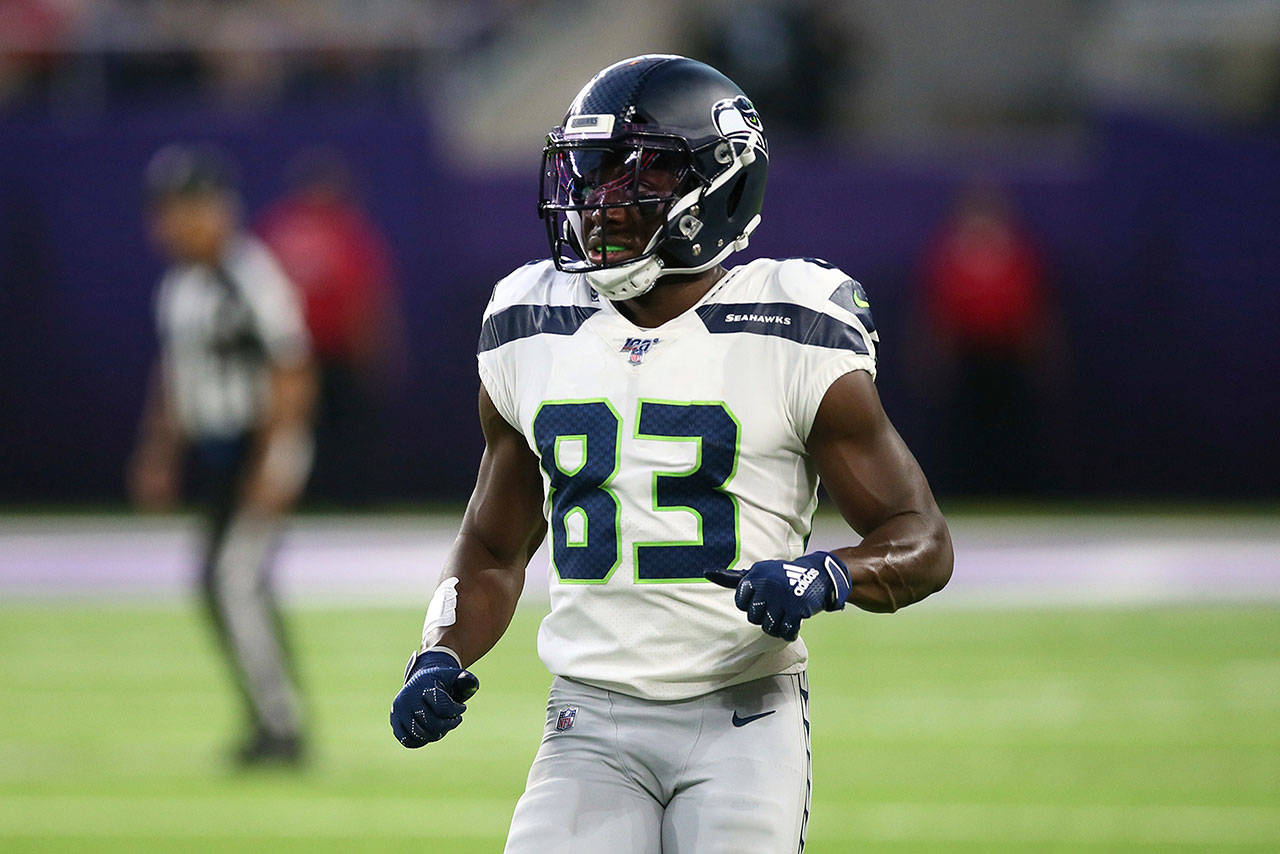 Seattle Seahawks wide receiver David Moore runs on the field during the first half of a preseason game against the Minnesota Vikings, Sunday, Aug. 18, 2019, in Minneapolis. (AP Photo/Jim Mone)