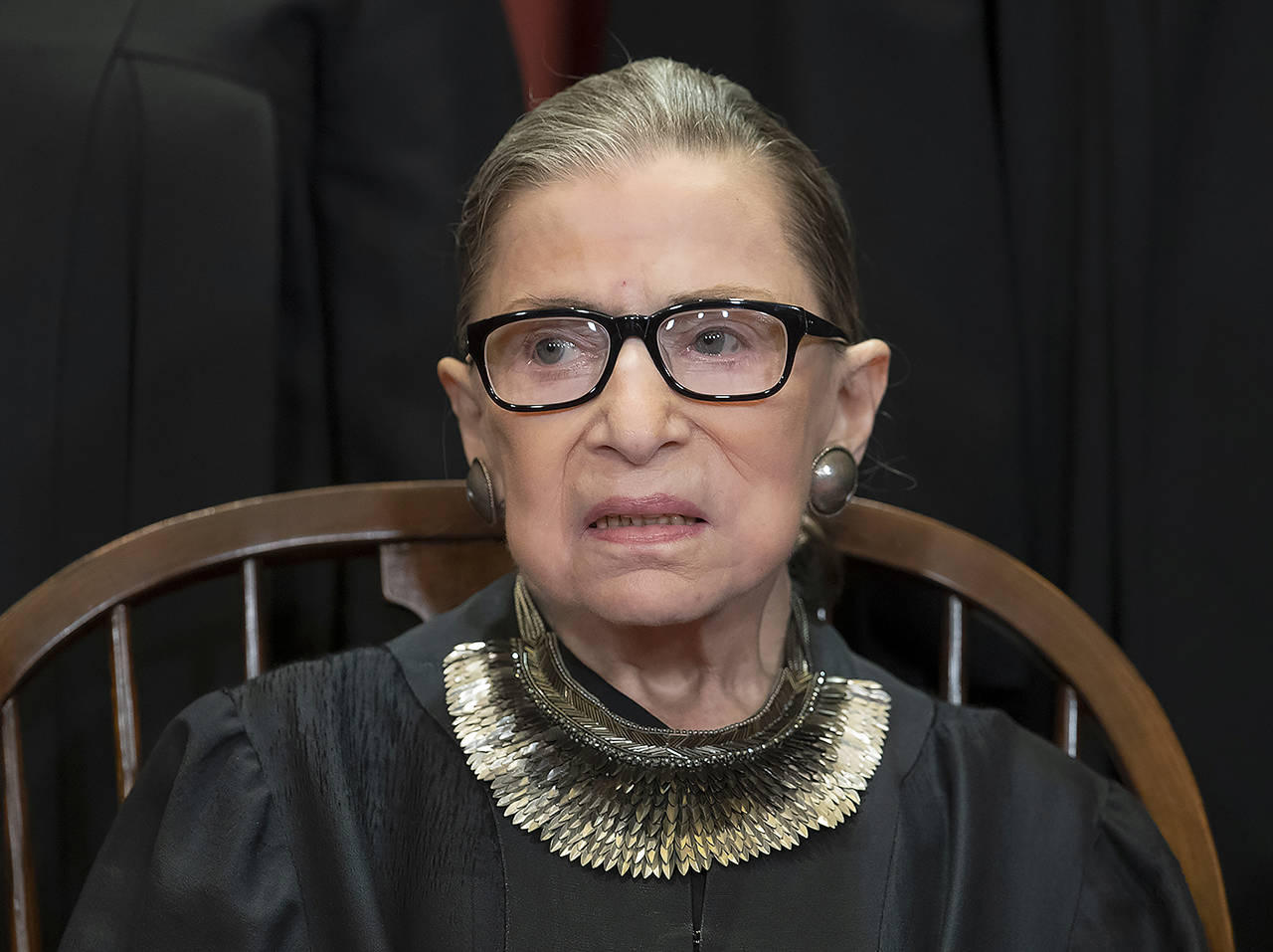 In this November 2018 photo, Associate Justice Ruth Bader Ginsburg sits with fellow Supreme Court justices for a group portrait at the Supreme Court Building in Washington. (AP Photo/J. Scott Applewhite, File)
